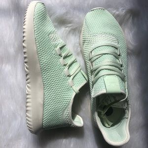 Mint green adidas tubular shadow